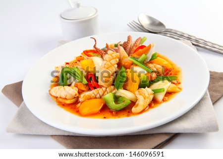 Stir fried squid with salted egg yolk - stock photo