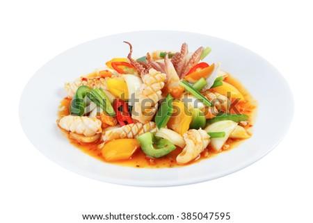 Stir-fried squid with salted egg yolk isolated on white (Pla Meuk Phad Kai Kem)  - stock photo