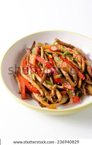 Stir Fried Tea Tree Mushroom with Chili Pepper on White Background - stock photo