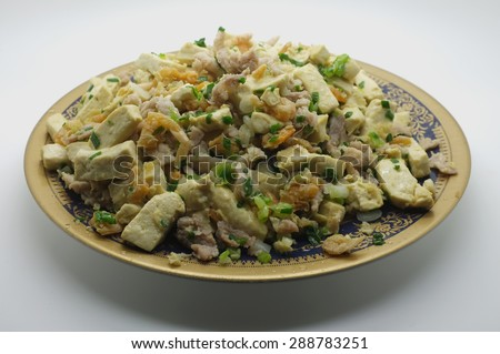 Stir fried tofu, bean curd with pork and dried shrimp - stock photo