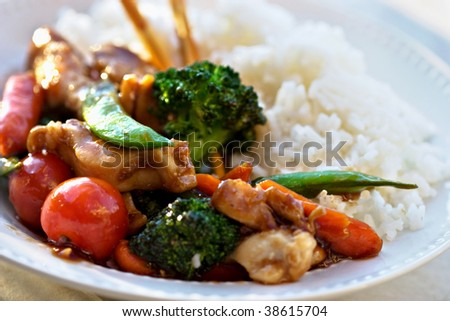 Stir Fried vegetables and chicken with rice. Selective focus on the center. - stock photo