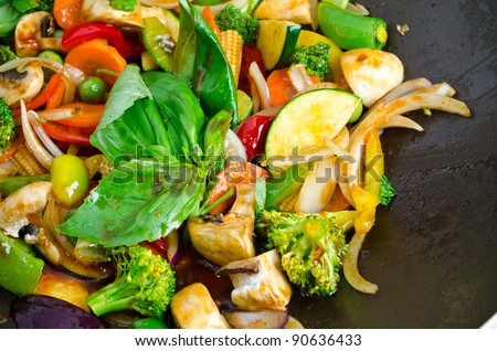 Stir-fried vegetables in a wok pan - stock photo