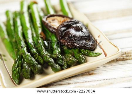 Stir fry asparagus with garlic and shiitake mushroom - stock photo