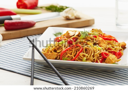 Stir fry chicken noodles - stock photo