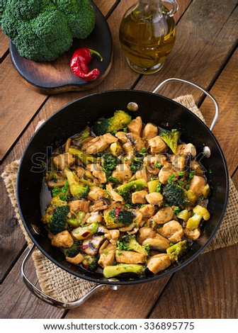 Stir fry chicken with  broccoli and mushrooms - Chinese food. Top view - stock photo
