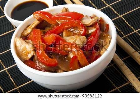 Stir fry chicken with sweet peppers - stock photo