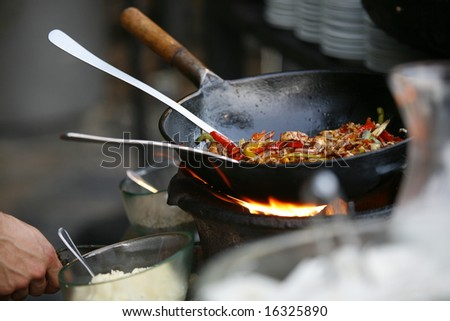 Stir fry in wok vegetables - stock photo