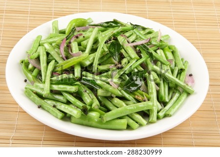 Stir fry organic  green beans with spices. - stock photo