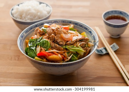Stir fry pork with vegetables and chilli sauce.