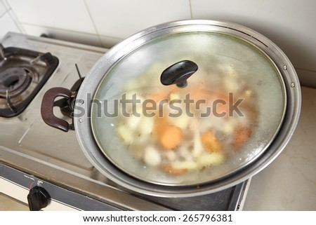 Stir frying cap cai or mixed vegetable, chinese cuisine in Indonesia - stock photo