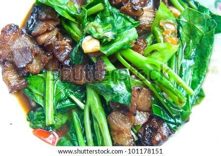 Stir frying crisp vegatables in a wok - stock photo