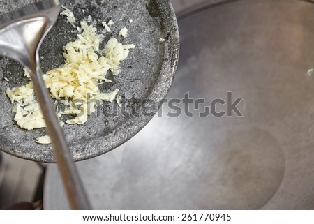 Stir frying the garlic - stock photo