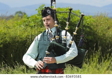 STIRLING, SCOTLAND, UK - JULY 10: An unidentified Piper competing in solo piping competition during Stirling Highland Games on July 10, 2011 in Stirling, Scotland, UK. - stock photo