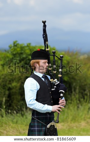 Stirling, Scotland, UK, JULY 10: Piper competing in solo piping competition during Stirling Highland Games on July 10, 2011 in Stirling, Scotland, UK. - stock photo