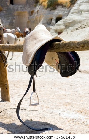 stirrup and saddle in sunny day - stock photo