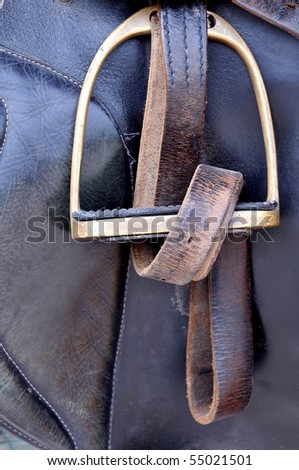 Stirrup with brown strap. - stock photo