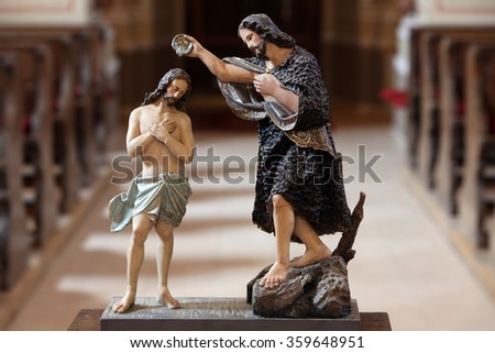 STITAR, CROATIA - AUGUST 27: Baptism of the Lord statue on the baptismal font in the church of Saint Matthew in Stitar, Croatia on August 27, 2015 - stock photo