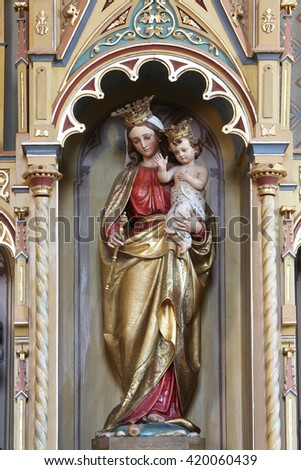 STITAR, CROATIA - AUGUST 27: Virgin Mary with baby Jesus statue on altar of Our Lady in the church of Saint Matthew in Stitar, Croatia on August 27, 2015 - stock photo
