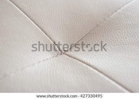 stitch of a gray sofa close up - stock photo