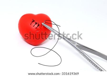 stitch suture on heart shape, heart  health concept - stock photo