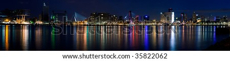 Stitched panorama of the city of Rotterdam and Mass River. Night scene - stock photo