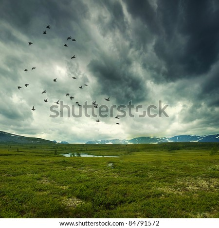 Stitched Panorama, wild nature with storm clouds - stock photo