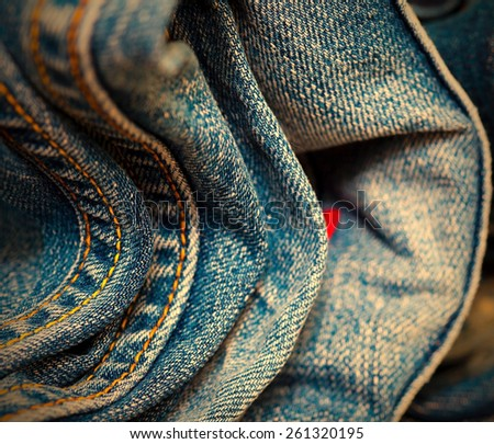 stitching on blue jeans, close-up. Shallow depth of field. instagram image retro style - stock photo