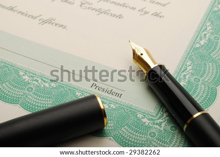 Stock certificate and a fountain pen - stock photo