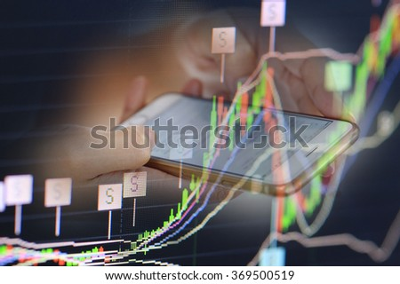 stock chart and finger use phone and tablet - stock photo