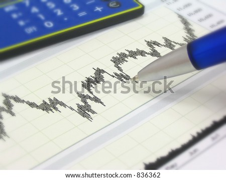 Stock chart, calculator and blue pen. Shallow depth of field. - stock photo