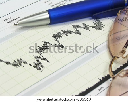 Stock chart, glasses and blue pen. - stock photo