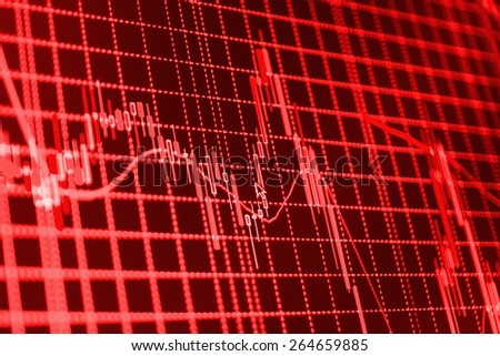 Stock chart graph of market share prices of company. Live on monitor desktop screen monitor. Business background. Red color.   - stock photo
