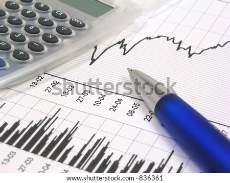 Stock chart, grey translucent calculator and blue pen. - stock photo