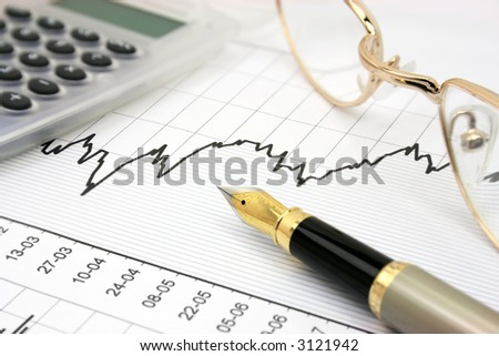 Stock chart with calculator, fountain pen and eyeglasses - stock photo