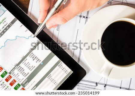 Stock Data Analysis by a cup of the coffee - stock photo