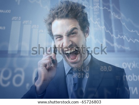 Stock exchange broker screaming to telephone - stock photo