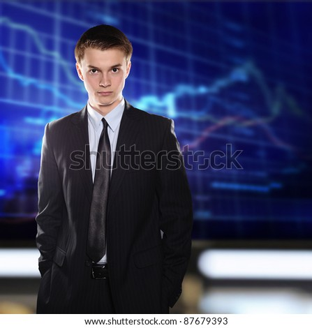 Stock Exchange Businessman  in a suit against a stock quote - stock photo