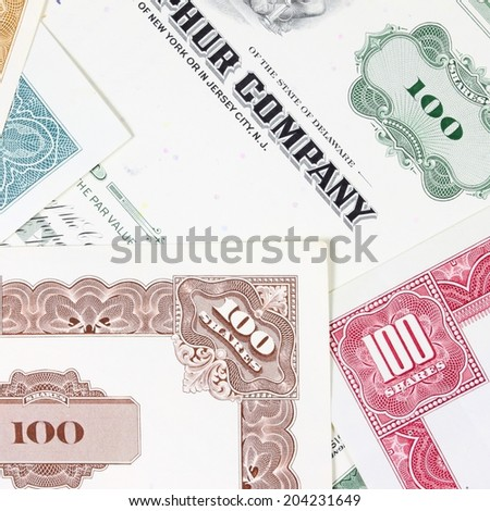 Stock exchange collectibles. Old stock share certificates from 1950s-1970s (United States). Vintage scripophily objects (obsolete). Square composition. - stock photo