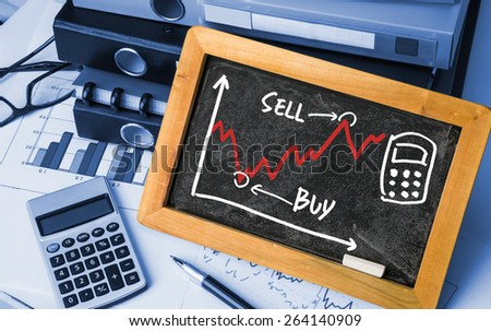 stock exchange concept graph hand drawing on blackboard - stock photo