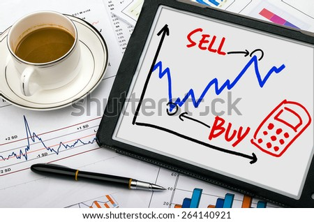 stock exchange concept graph hand drawing on tablet pc - stock photo