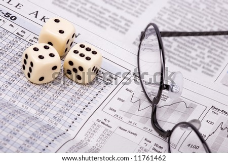 Stock-exchange in financial newspaper and dice - gambling - stock photo