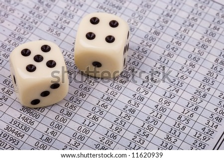 Stock-exchange in newspaper and dice - gambling
