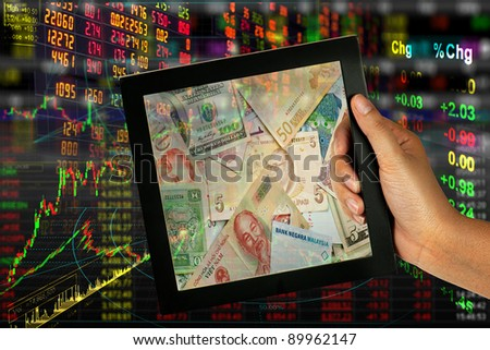stock exchange to bank note in frame - stock photo
