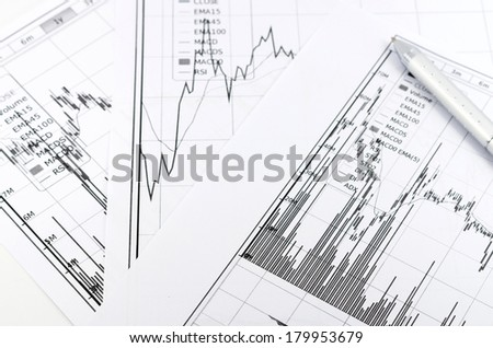 stock graph report with pen for business - stock photo