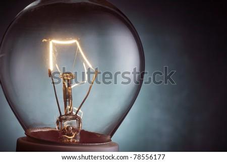 stock image close up of the light bulb illuminated - stock photo