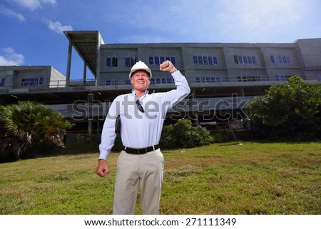 Stock image of a construction contractor pumping his fist in the air - stock photo
