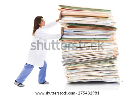 Stock image of a female healthcare worker pushing a giant stack of papers isolated on white background