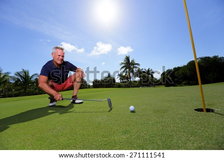 Stock image of a golfer studying his next shot - stock photo