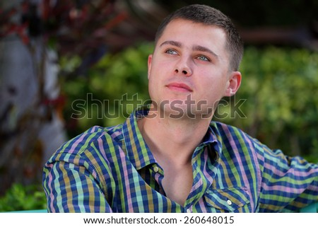 Stock image of a man pondering and looking away - stock photo