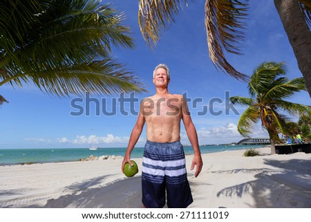Stock image of a man posing on the beach without a shirt - stock photo